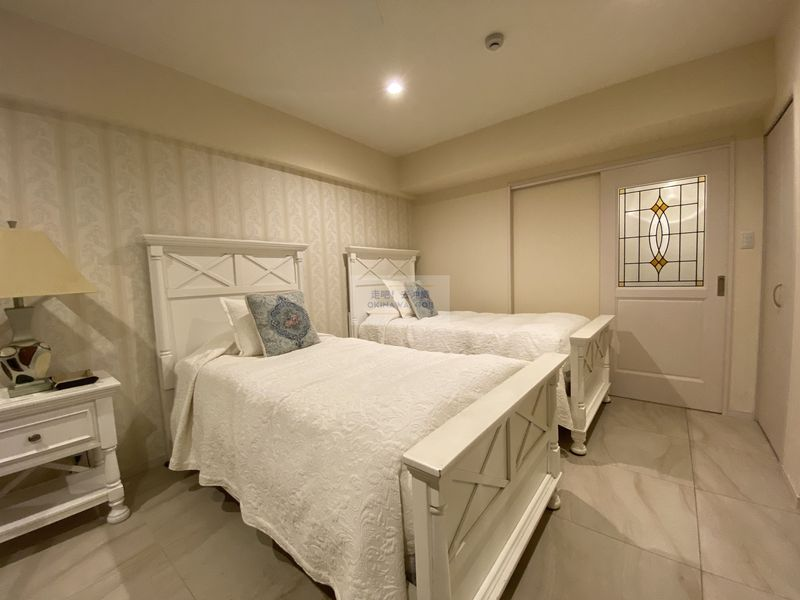 Wisteria公寓度假村-床鋪區域